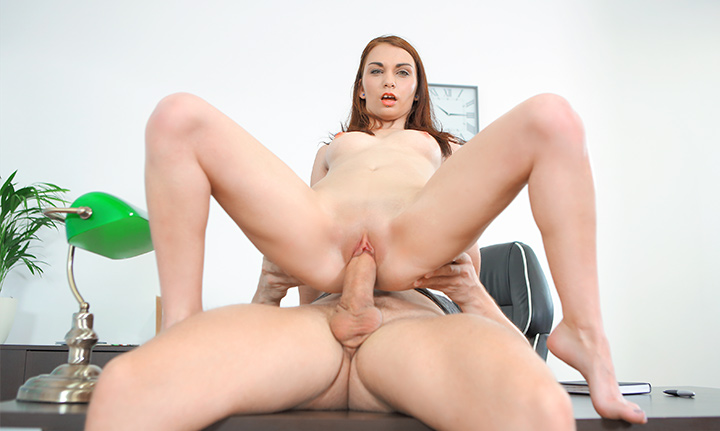 Slim cutie gets her orgasms on the table
