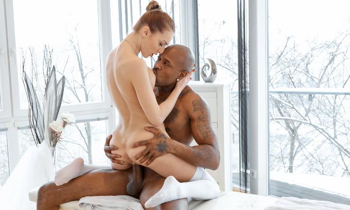 Slender babe gives black dude a full-body massage